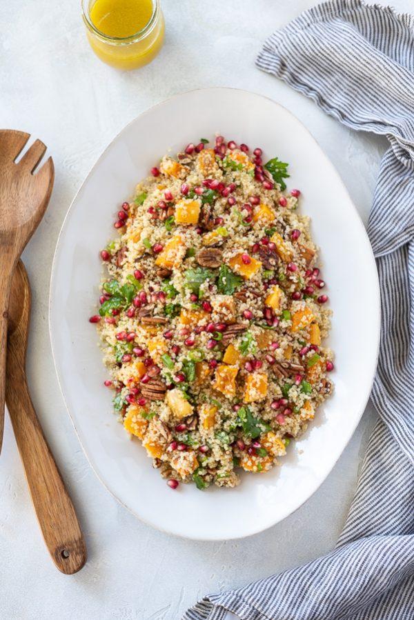 overhead of butternut squash quinoa salad on a platter