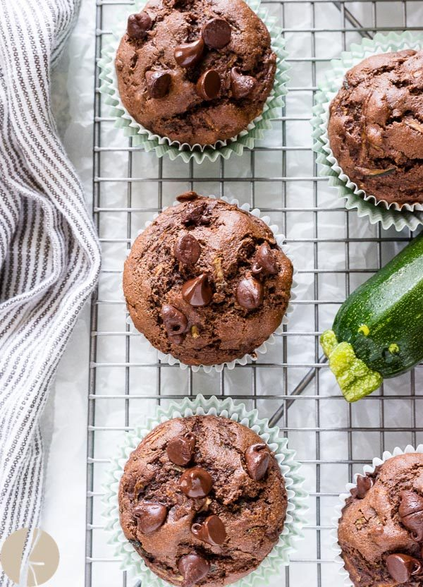 Chocolate zucchini muffins on wire rack