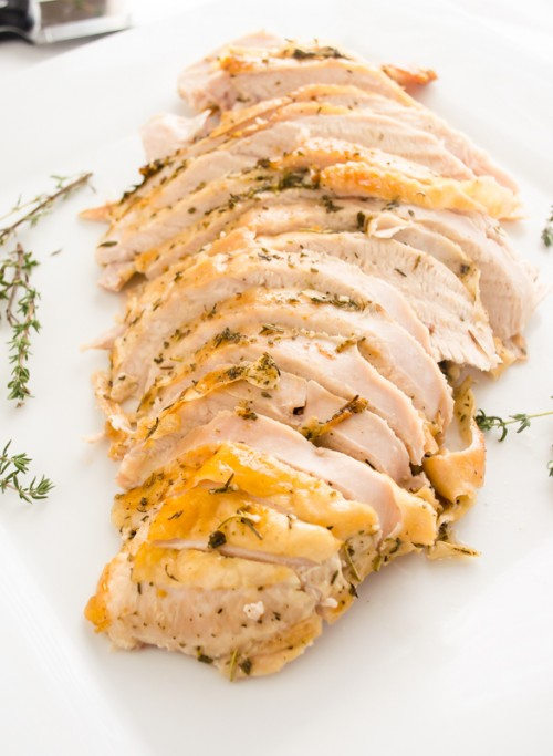Front view of roast turkey breast sliced on a platter