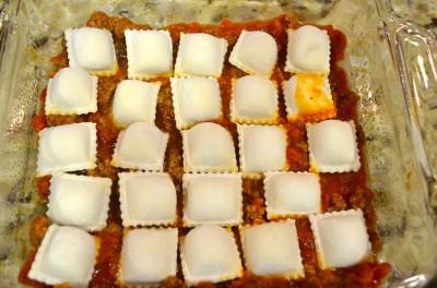 layering baked ravioli