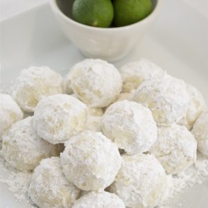 Key lime cooler cookies piled on a white plate