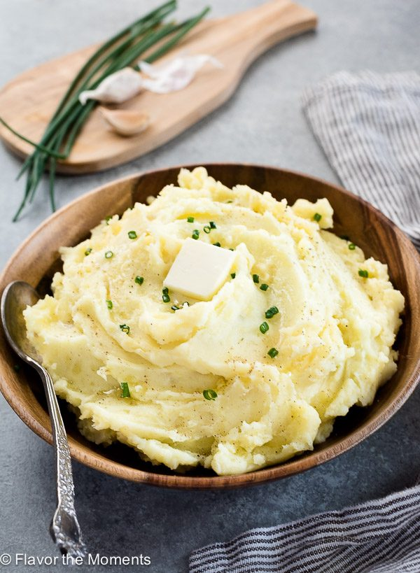 Front view of yukon gold mashed potatoes with spoon