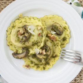 wild mushroom ravioli with pesto and toasted walnuts