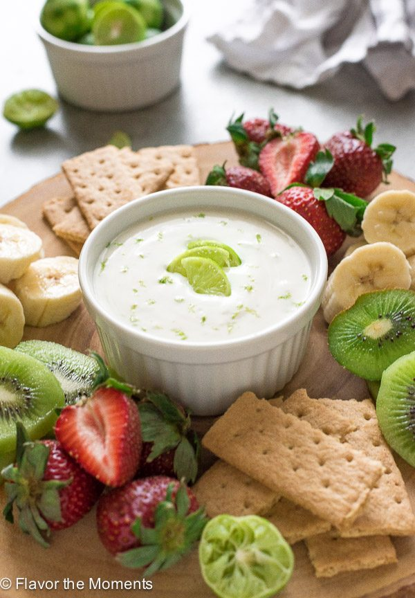 Key lime Greek yogurt dip on serving plate with fruit and graham crackers
