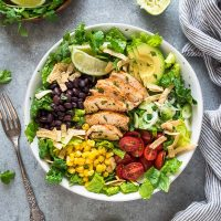 Santa fe chicken salad in white bowl with lime