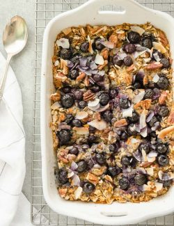 blueberry morning glory baked oatmeal in white baking dish