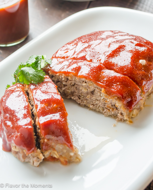 Turkey Meatloaf with Homemade Barbecue Sauce is moist and juicy with a tangy barbecue sauce. This definitely ain't your mama's meatloaf! @FlavortheMoments