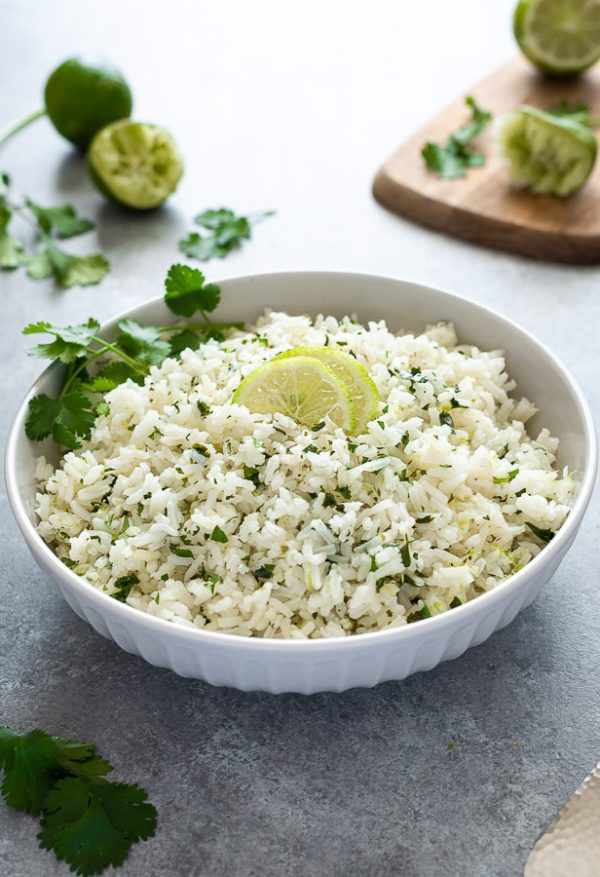 bowl of cilantro lime rice with sliced lime on top