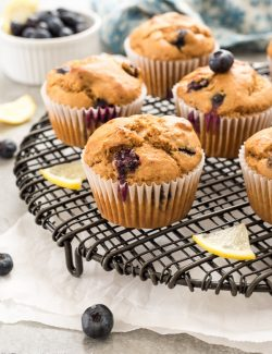 Blueberry lemon muffins on wire rack with lemon slices