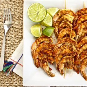 Spicy Lime Grilled Shrimp is juicy, succulent grilled shrimp with tangy lime flavor and plenty of spice! Serve with rice or quinoa for the perfect quick and easy meal!