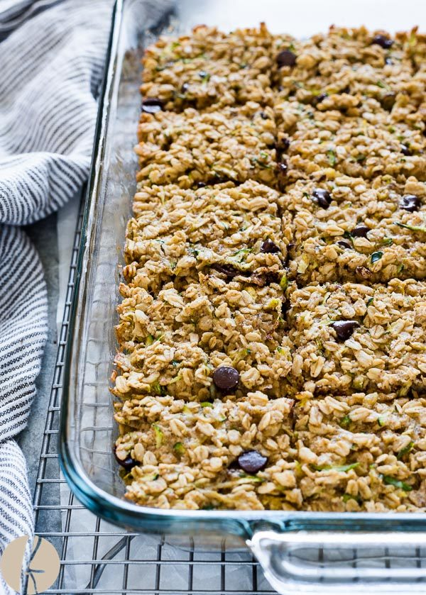 Oatmeal zucchini snack bars cut into squares in baking pan