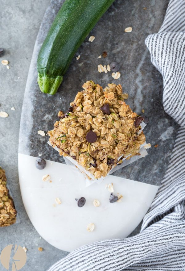 Overhead shot of oatmeal zucchini snack bars stacked up