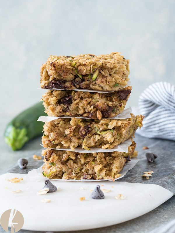 Front view of oatmeal zucchini snack bars in a stack