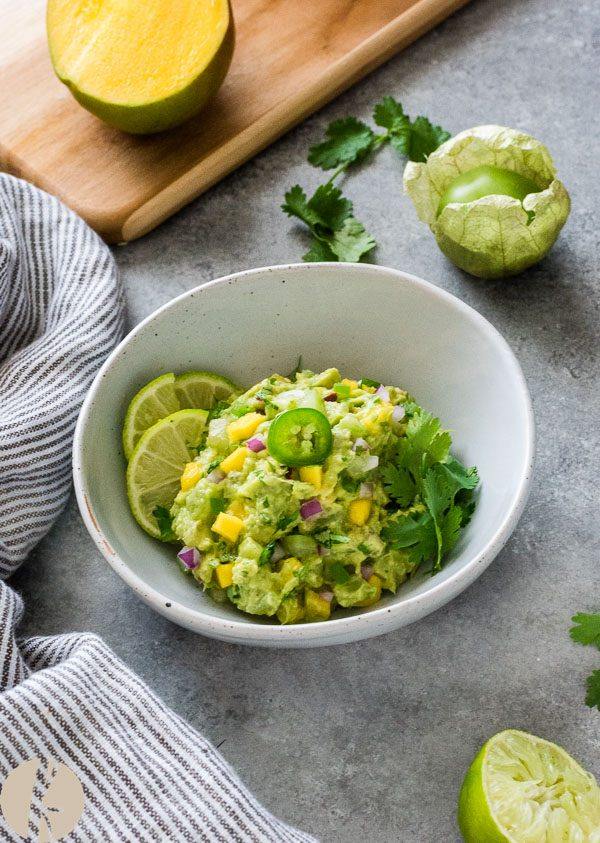 Mango Tomatillo Guacamole is creamy guacamole with a blend of sweet and savory flavors that will keep you coming back for more!