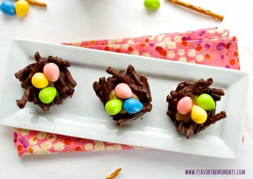 Chocolate pretzel bird nests on serving plate