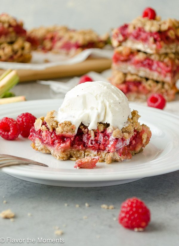 Raspberry crisp bar with ice cream on top and bite removed