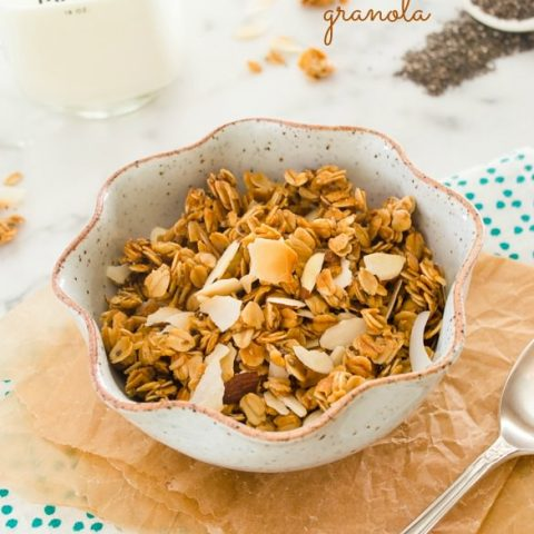 Honey almond granola in bowl with spoon