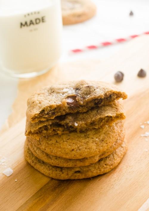 Stack of sea salt chocolate chip cookies with top cookie broken in half