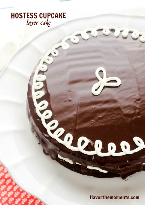 Hostess cupcake layer cake on white pedestal server