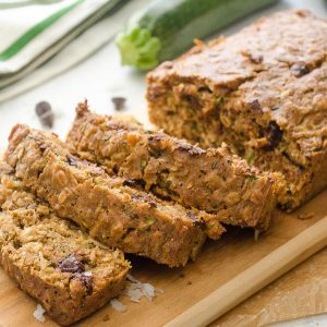 Oatmeal Coconut Chocolate Chip Zucchini Bread sliced on cutting board