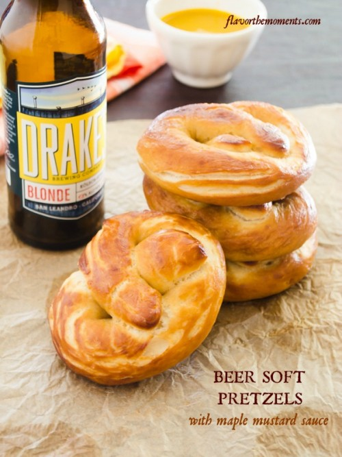Homemade soft pretzels with beer bottle and pretzels stacked up