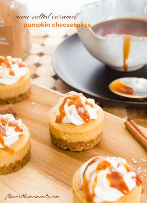 Pumpkin cheesecake on wooden cutting board with cinnamon stick