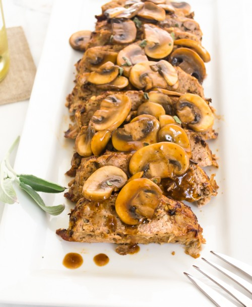 Turkey meatloaf with mushrooms on a platter