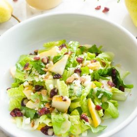 Cranberry Pear Salad with Fresh Pear Vinaigrette is an addicting blend of crisp romaine, juicy pear, dried cranberries, feta cheese, and toasted almonds tossed in a fresh pear vinaigrette!