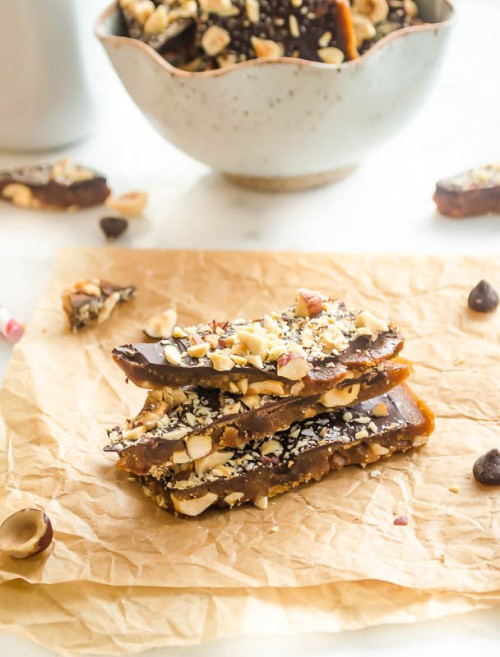 Stack of dark chocolate english toffee on parchment paper