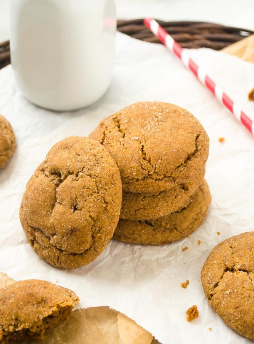 Stack of gingersnap cookies with a cookie leaning against it