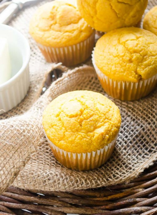 Close up of butternut squash cornbread muffins on burlap