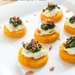 Oven baked polenta crostini with pesto and ricotta