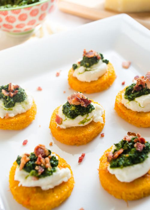 Close up of sweet potato polenta rounds on serving plate
