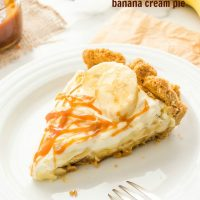 Slice of banana cream pie with salted caramel on top