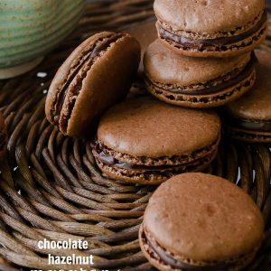 Chocolate macarons piled on serving platter