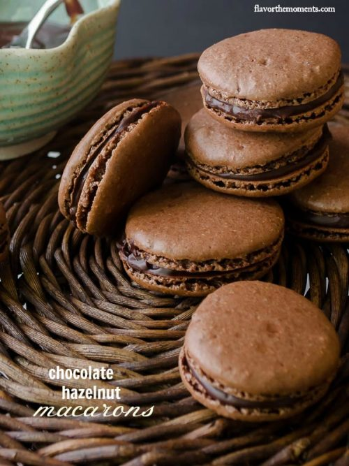 Chocolate macarons stacked up on serving platter