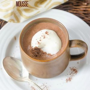 Chocolate mocha mousse in a coffee cup with bite taken out