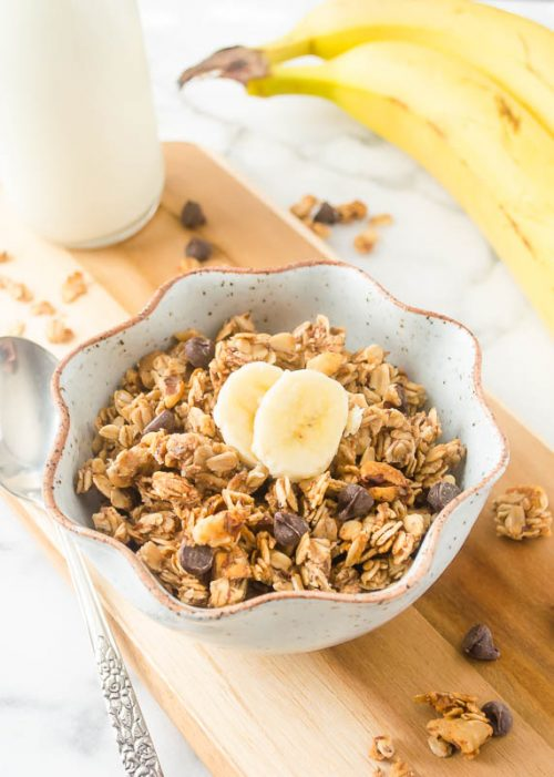 Banana chocolate chip granola in a bowl with banana on top