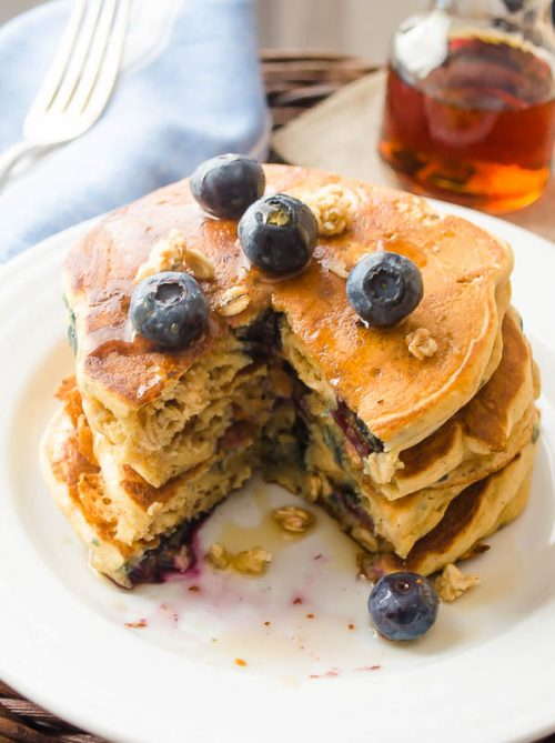 Blueberry granola pancakes on a white plate