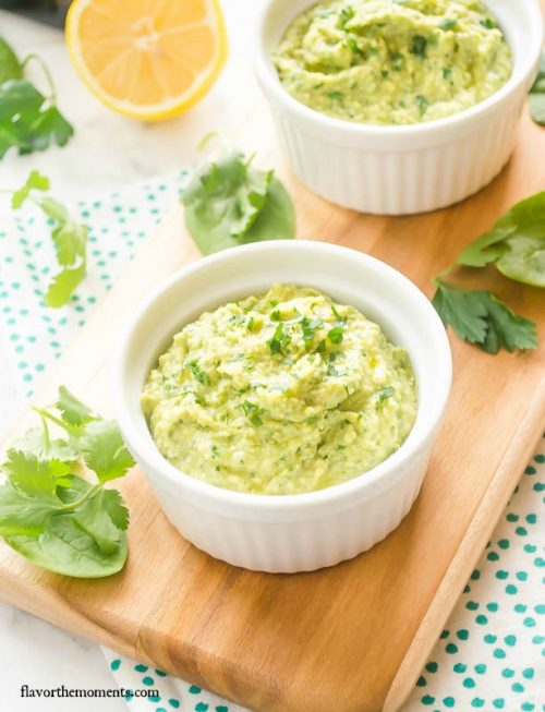 Close up of green hummus in serving dish