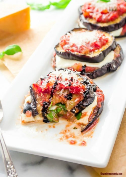 Half eaten eggplant parmesan stacks with balsamic drizzle