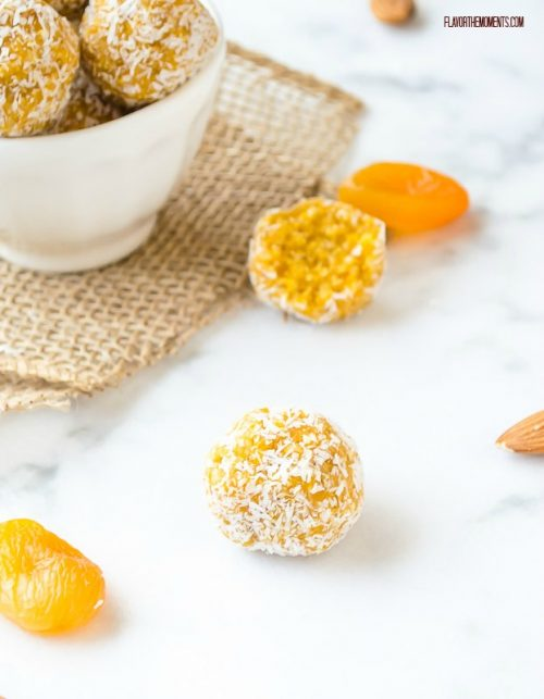 Apricot energy balls with coconut on marble board