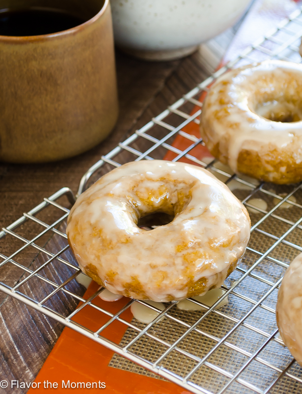 close up of baked pumpkin donuts with espresso glaze
