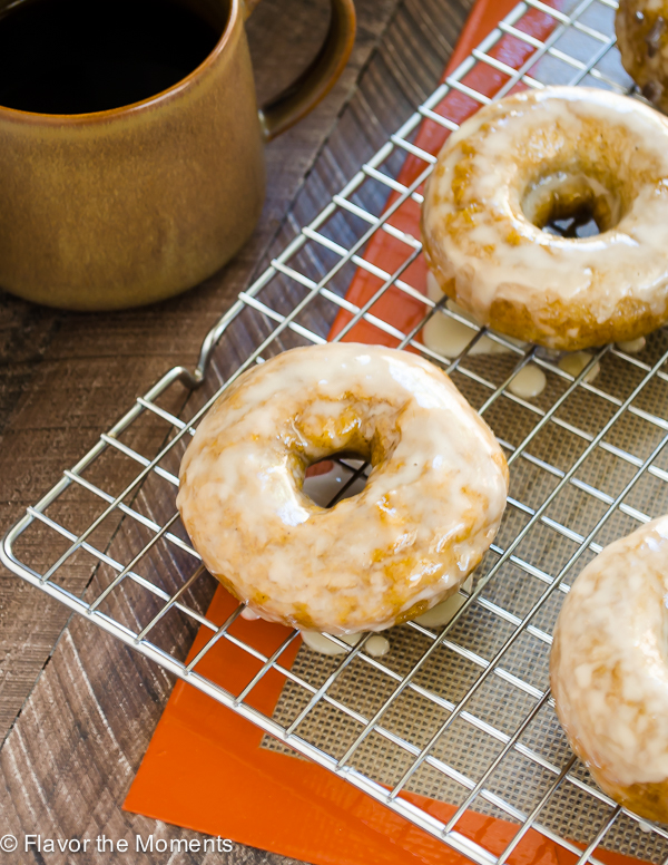 Espresso Glazed Baked Pumpkin Donuts on a wire rack