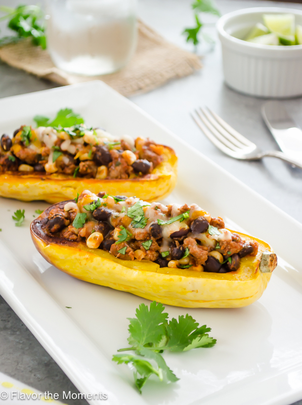 southwest turkey chili stuffed delicata squash on a white serving platter