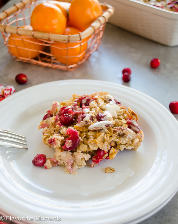 Cranberry Orange Baked Oatmeal with Orange Cream Cheese Glaze is bursting with flavor and perfect for a holiday breakfast or brunch! @FlavortheMoment