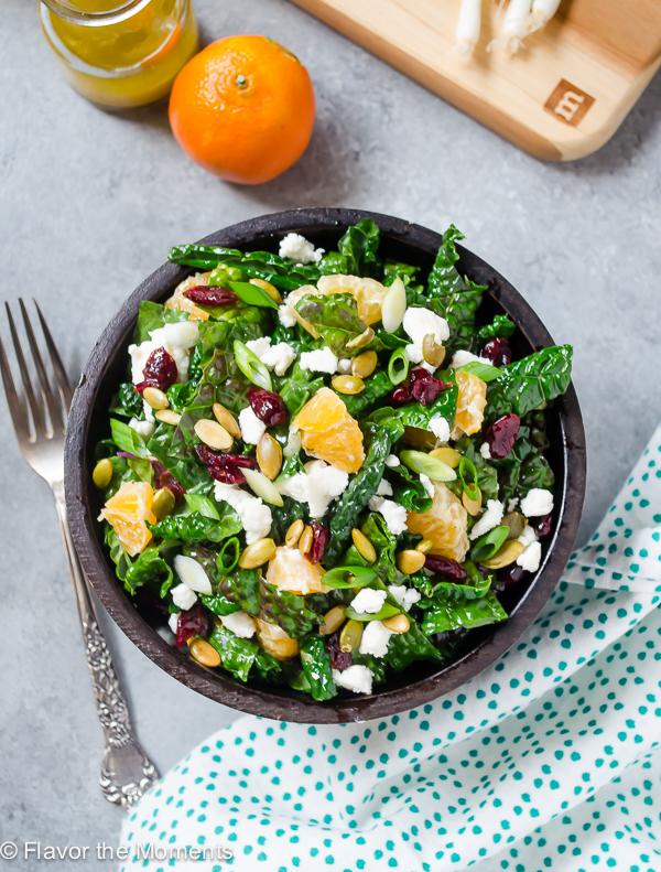 overhead shot of citrus kale salad with fork alongside