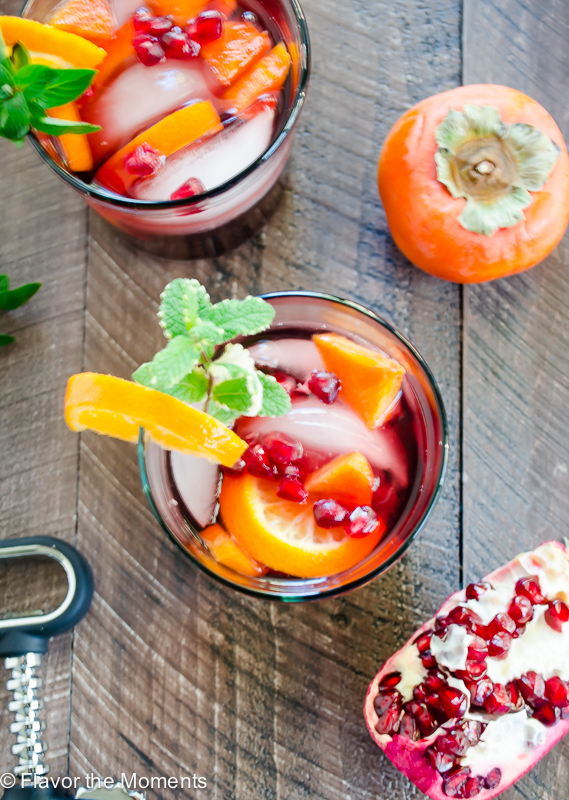 Red Sangria with Orange, Persimmon, and Pomegranate is classic red sangria that's easy to make and sure to impress! It's refreshing, festive, and perfect for entertaining! @FlavortheMoment