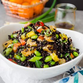 Asian Black Rice Salad with Ginger Orange Dressing is an exotic mix of black rice, edamame, crunchy vegetables and juicy oranges with a ginger-orange dressing.