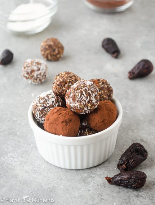 Fig Almond Energy Bite Truffles are easy, 4-ingredient vegan energy bites rolled into cocoa powder and coconut for a fun and healthy snack or treat! @FlavortheMoment